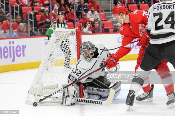 Los Angeles Kings goalie Jonathan Quick pokes the puck away from Detroit Red Wings right wing Anthony Mantha during the Detroit Red Wings game versus...