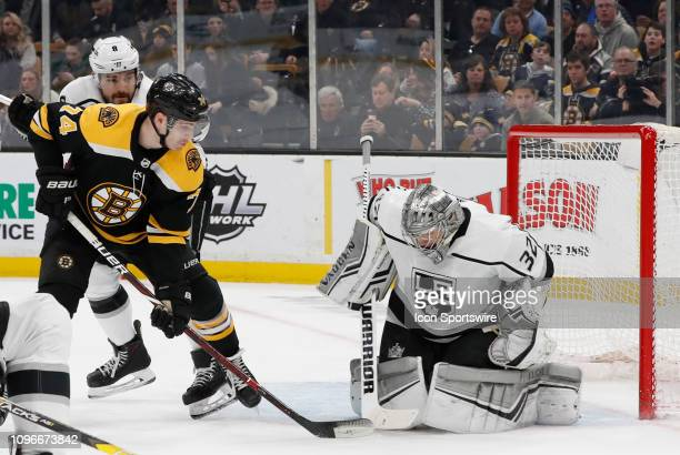 Los Angeles Kings goalie Jonathan Quick stops the puck with Boston Bruins left wing Jake DeBrusk in front during a game between the Boston Bruins and...