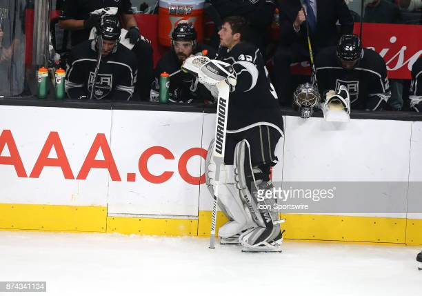 Los Angeles Kings goalie Jonathan Quick talks with Los Angeles Kings defenceman Drew Doughty during a timeout during the game against the Vancouver...
