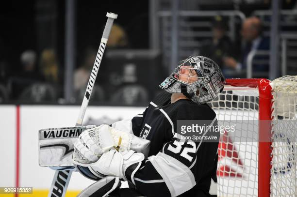 Los Angeles Kings Goalie Jonathan Quick taps his helmet on the crossbar and closes his eyes during an NHL game between the Pittsburgh Penguins and...