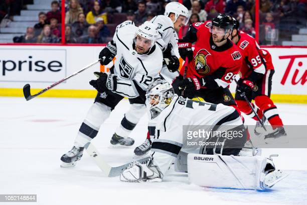 Los Angeles Kings Goalie Peter Budaj looks for a rebound cleared away by Los Angeles Kings Defenceman Alec Martinez during second period National...