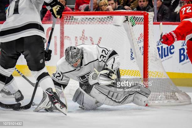 Los Angeles Kings goaltender Jonathan Quick drops on a rebound off of the stick of Detroit Red Wings center Andreas Athanasiou during the Detroit Red...