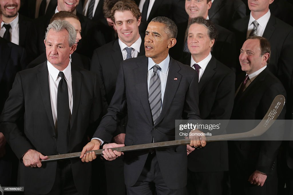 Los Angeles Kings Head Coach Darryl Sutter (L) presents U.S. President Barack Obama with a silver hockey stick as Obama hosted the National Hockey League champions in the East Room of the White House February 2, 2015 in Washington, DC. Obama simultaneously hosted the Major League Soccer champions Los Angeles Galaxy. Both teams are owned in part by billionaire and The Weekly Standard publisher Philip Anschutz.