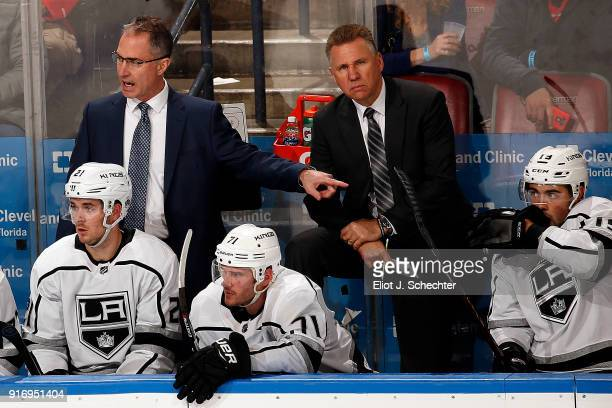 Los Angeles Kings Head Coach John Stevens directs his team from the bench along with Assistant Coach Don Nachbaur against the Florida Panthers at the...