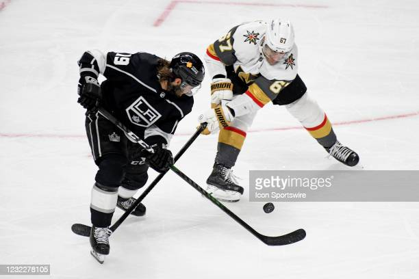 Los Angeles Kings Left Wing Alex Iafallo and Vegas Golden Knights Left Wing Max Pacioretty battle for the puck during an NHL game between the Las...