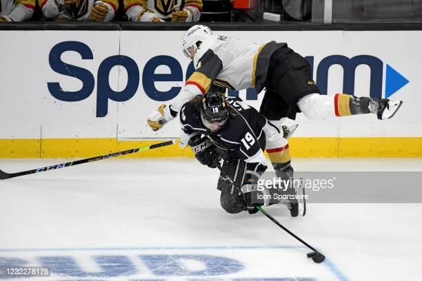 Los Angeles Kings Left Wing Alex Iafallo and Vegas Golden Knights Defenceman Brayden McNabb collide hard along the boards during an NHL game between...