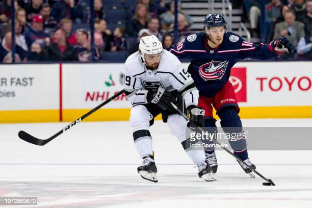 Los Angeles Kings left wing Alex Iafallo keeps the puck away from Columbus Blue Jackets center Alexander Wennberg in a game between the Columbus Blue...