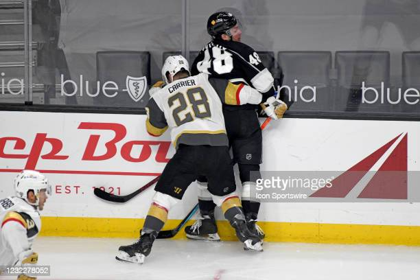 Los Angeles Kings Left Wing Brendan Lemieux and Vegas Golden Knights Left Wing William Carrier collide along the boards during an NHL game between...
