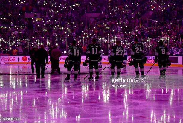 Los Angeles Kings line up for 'Hockey Fights Cancer Night' before the game against the Winnipeg Jets at Staples Center on November 22 2017 in Los...