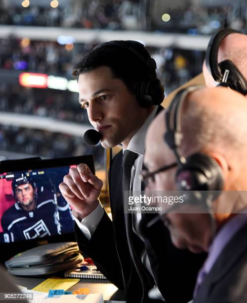 Los Angeles Kings playbyplay announcer Alex Faust calls the game as former Kings announcer Bob Miller visits the broadcasting booth during the game...
