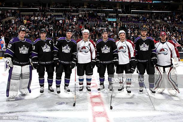 Los Angeles Kings players Jonathan Quick Dustin Brown Jack Johnson Drew Doughty and Michal Handzus stand with Colorado Avalanche players Paul Stastny...