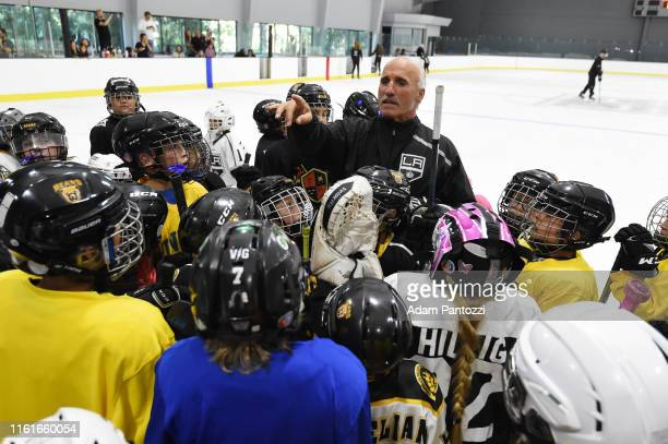 Los Angeles Kings Radio PlayByPlay Announcer Daryl Evans speaks to youth hockey players during the LA Kings Pickwick Ice Center Grand ReOpening at LA...