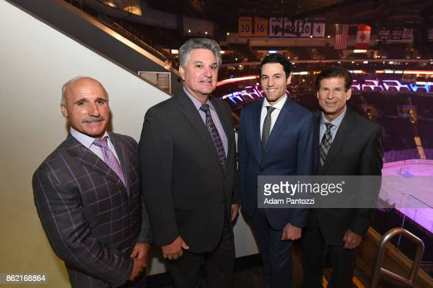 Los Angeles Kings radio playbyplay announcers Daryl Evans and Nick Nickson pose for a photo with TV playbyplay announcers Alex Faust and Jim Fox...