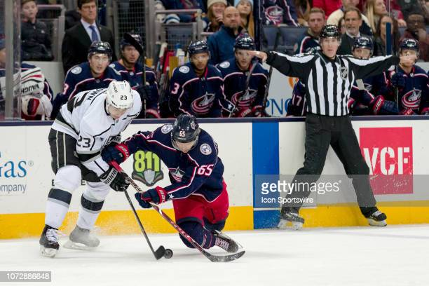 Los Angeles Kings right wing Dustin Brown and Columbus Blue Jackets defenseman Markus Nutivaara battle for the puck in a game between the Columbus...