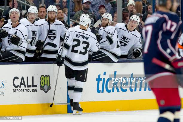 Los Angeles Kings right wing Dustin Brown celebrates with teammates on the bench after scoring a goal in a game between the Columbus Blue Jackets and...