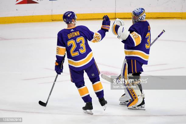 Los Angeles Kings Right Wing Dustin Brown congratulates Los Angeles Kings Goalie Jonathan Quick following a Kings victory during an NHL game between...
