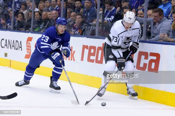 Los Angeles Kings Right Wing Tyler Toffoli and Toronto Maple Leafs Defenceman Travis Dermott battle for the puck during the NHL regular season game...