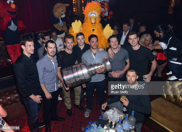 Los Angeles Kings team members Tyler Toffoli Drew Doughty Jarret Stoll Alec Martinez Brayden McNabb Martin Jones and Trevor Lewis appear with the...