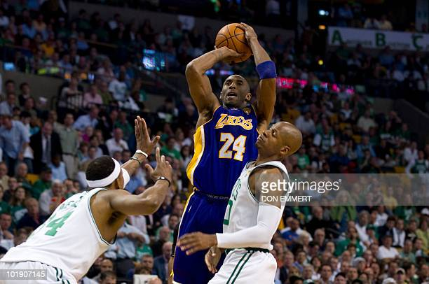 Los Angeles Kobe Bryant gets a shot off against the Boston Celtics Paul Pierce and Ray Allen during game three of the NBA Finals on June 8 2010 in...