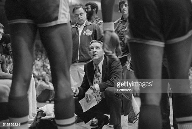 Los Angeles Laker coach Bill Sharman looks up at his 'big men' as he maps strategy during time out in their game against the Cleveland Cavaliers on...