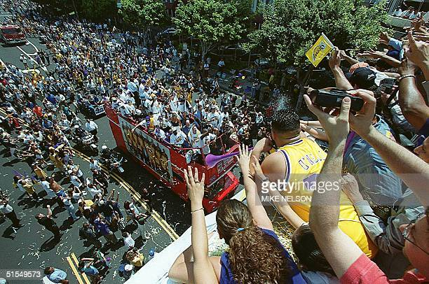 Los Angeles Laker fans celebrate as double decker buses carrying the team during the 21 June 2000 victory parade in downtown Los Angeles. Over...