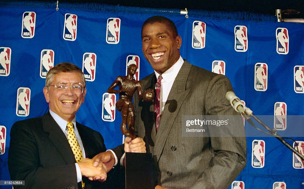 Magic Johnson and David Stern Shaking Hands : News Photo