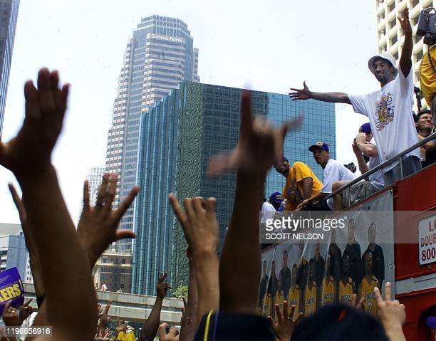 Los Angeles Laker Kobe Bryant celebrates with fans during the 21 June 2000 victory parade in downtown Los Angeles. Over 200,000 fans attended the...