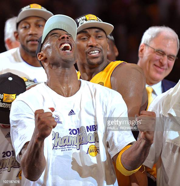 Los Angeles Laker Kobe Bryant reacts stands with teammates and coach Phil Jackson as he is announced MVP following the Lakers victory in Game 7 of...