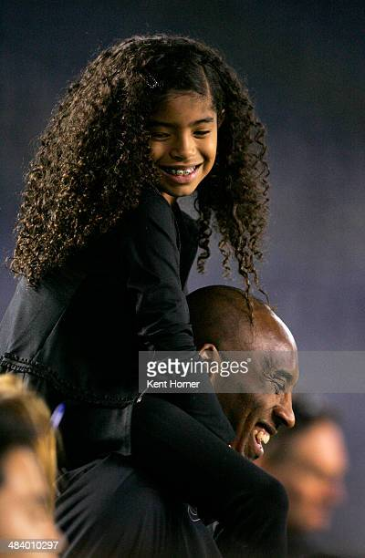 Los Angeles Laker Kobe Bryant stands on the sideline with his daughter Gianna Maria-Onore Bryant on his shoulders prior to the start of the game...