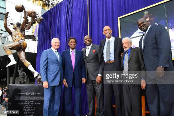 Los Angeles Laker legends pose after the unveiling of a statue of Minneapolis and Los Angeles Lakers and Hall of Famer Elgin Baylor second from left...