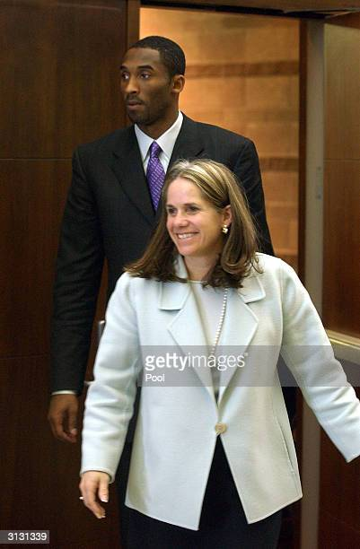 Los Angeles Lakers basketball player Kobe Bryant and his attorney Pamela Mackey leave the Eagle County Justice Center courtroom for a break on the...