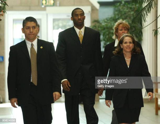 Los Angeles Lakers basketball player Kobe Bryant and his attorney Pamela Mackey walk to the courtroom inside the Eagle County Justice Center on the...