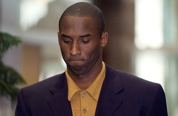 Los Angeles Lakers' basketball player Kobe Bryant makes his way into the Eagle County Justice Center for a preliminary hearing October 9, 2003 in...
