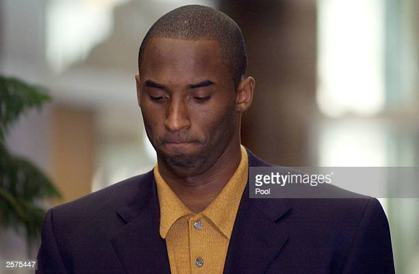 Los Angeles Lakers' basketball player Kobe Bryant makes his way into the Eagle County Justice Center for a preliminary hearing October 9 2003 in...