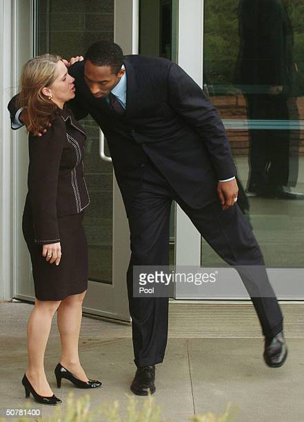 Los Angeles Lakers basketball player Kobe Bryant talks to Attorney Pamela Mackey after leaving the Eagle County Justice Center April 28 2004 in Eagle...