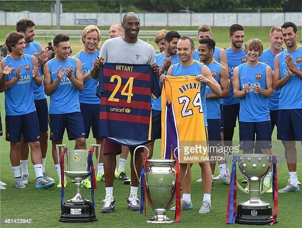 Los Angeles Lakers basketball star Kobe Bryant and Barcelona team captain Andrés Iniesta Luján pose with other members of the FC Barcelona football...