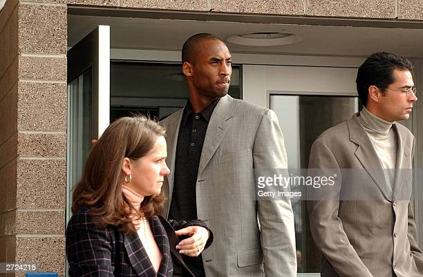 Los Angeles Lakers Basketball star Kobe Bryant and defense attorney Pamela Mackey leave an Eagle County court room after an arraignment to hear the...