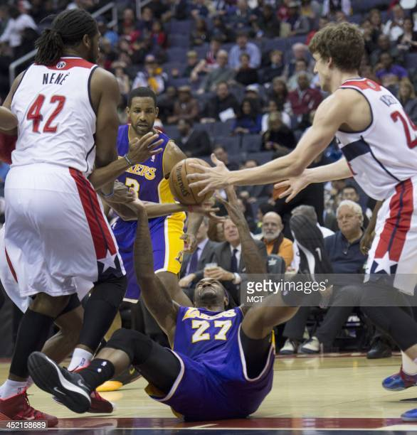 Los Angeles Lakers center Jordan Hill battles for the ball with Washington Wizards power forward Jan Vesely during the first half of their game...