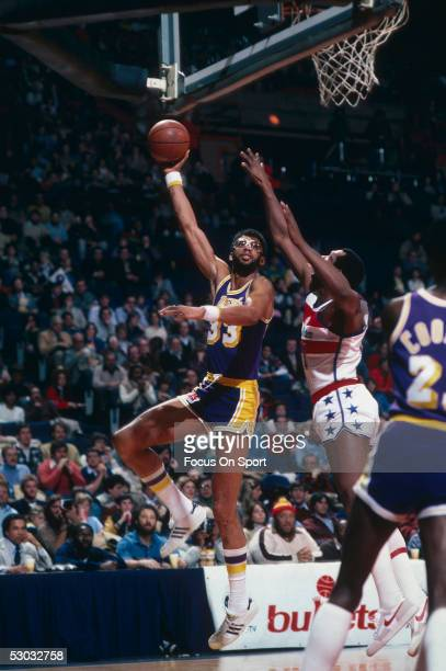 Los Angeles Lakers' center Kareem Abdul Jabbar jumps and makes a hook shot against the Washington Bullets during a game at Capital Center circa 1978...
