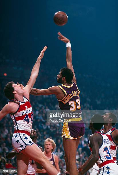 Los Angeles Lakers' center Kareem Abdul Jabbar jumps and shoots against the Washington Bullets during a game at Capital Center circa the 1970's in...