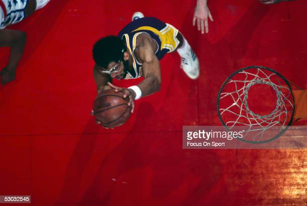 Los Angeles Lakers' center Kareem Abdul Jabbar jumps for a layup against the Washington Bullets during a game at Capital Center circa 1978 in...