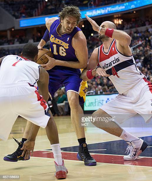 Los Angeles Lakers center Pau Gasol is guarded by Washington Wizards small forward Trevor Ariza left and center Marcin Gortat during the first half...