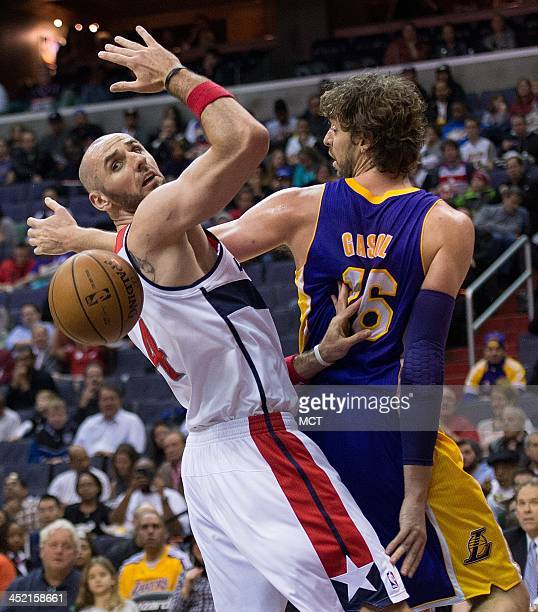 Los Angeles Lakers center Pau Gasol looses control of the ball while battling against Washington Wizards center Marcin Gortat during the first half...
