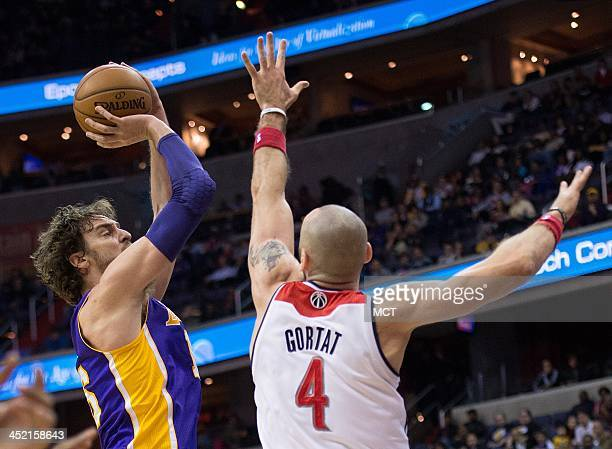 Los Angeles Lakers center Pau Gasol shoots over Washington Wizards center Marcin Gortat during the first half of their game played at the Verizon...