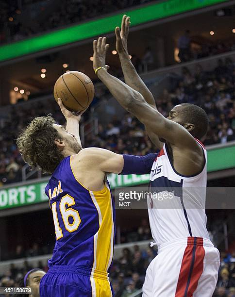 Los Angeles Lakers center Pau Gasol shoots over Washington Wizards small forward Martell Webster during the first half of their game played at the...