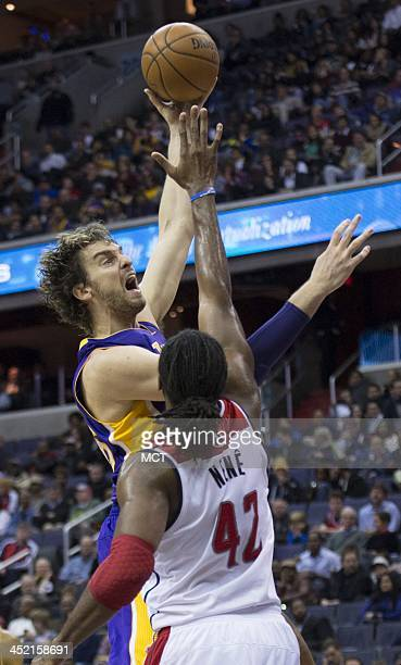 Los Angeles Lakers center Pau Gasol shoots over Washington Wizards power forward Nene Hilario during the first half of their game played at the...