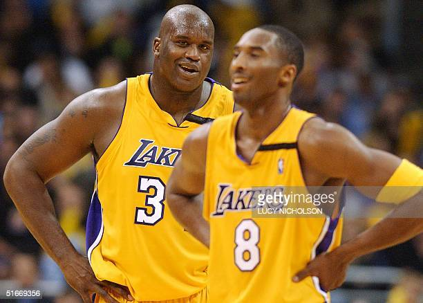 Los Angeles Lakers' center Shaquille O'Neal laughs with guard Kobe Bryant in the fourth quarter during the Lakers' 8673 win against the Chicago Bulls...