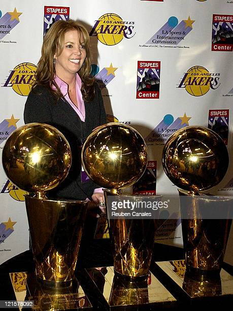 Los Angeles Lakers Executive Vice President Jeanie Buss poses with the three world champion trophies on display at the Basketball 101 The Ultimate...
