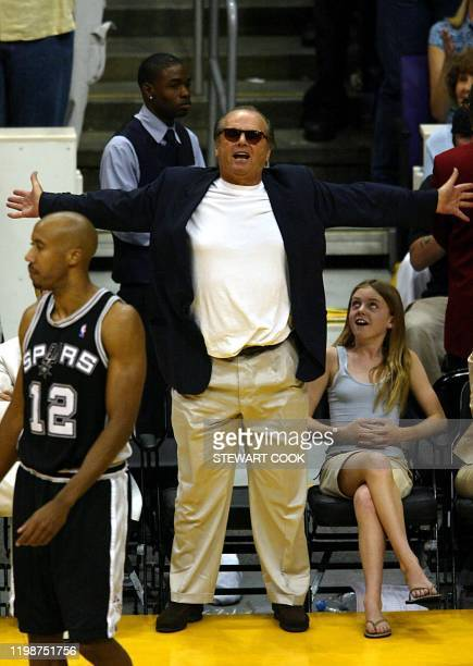 Los Angeles Lakers fan and actor Jack Nicholson reacts to a referee's call during 2nd quarter action 11 May at the Staples Center in Los Angeles in...