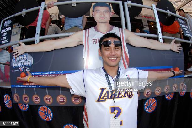 Los Angeles Lakers fan Jasper Salon compares his arm span to a cut out of the Houston Rockets' Yao Ming during the NBA Nation Tour on May 18 2008 at...